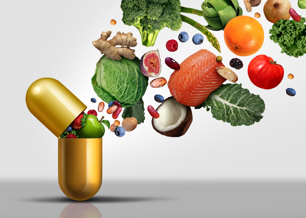 Food going into vitamin capsule