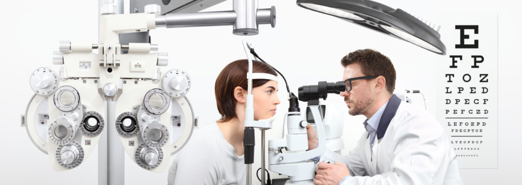 Optometrist examining patients eye