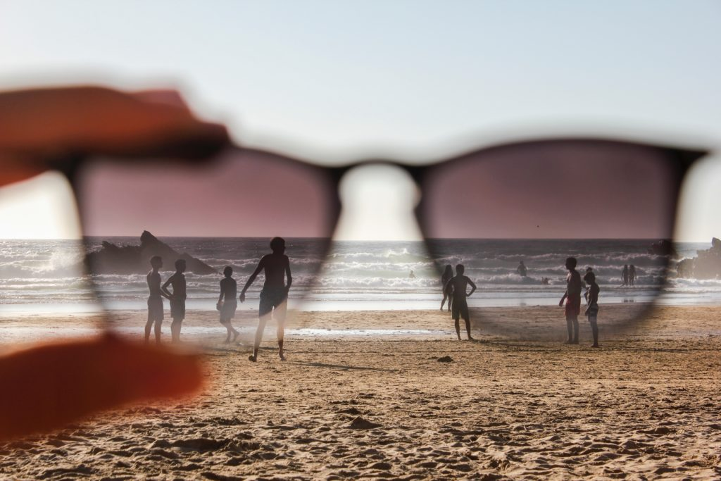 Looking through sunglasses at a beach scene