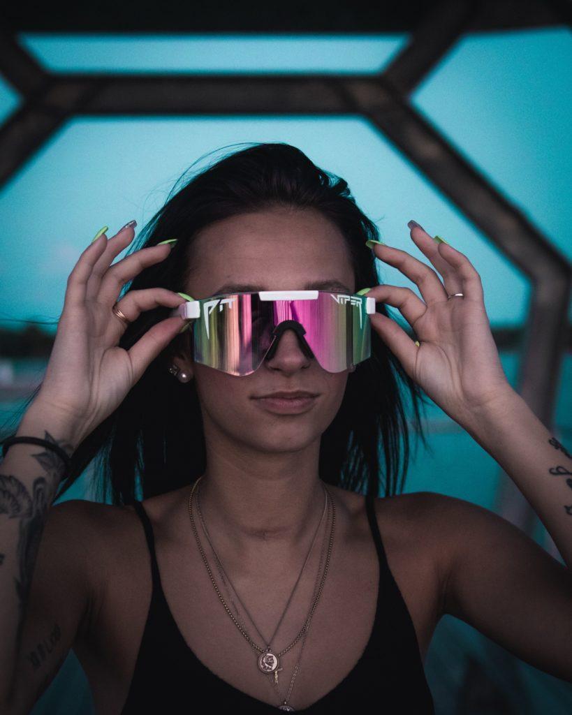 Female wearing pit viper sunglasses